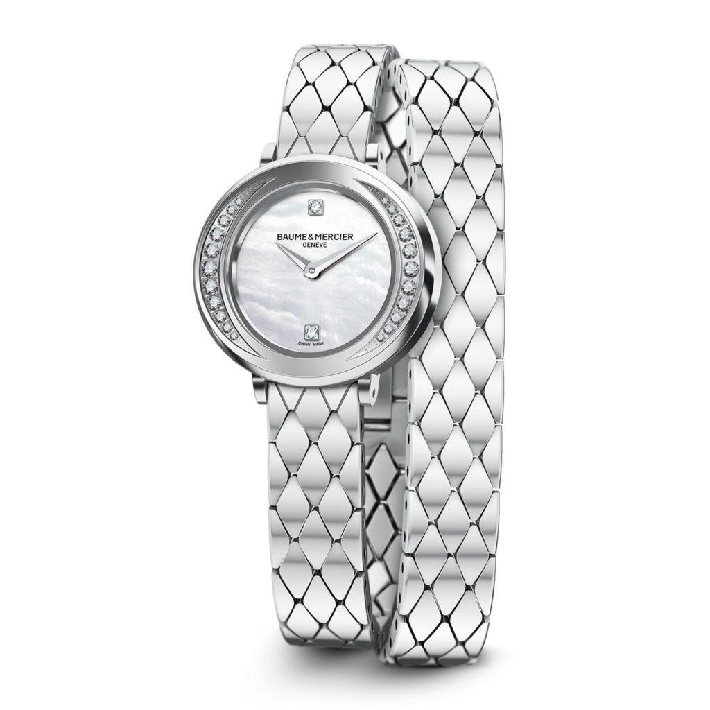 El reloj engastado Promesse 10289 para mujer es un reloj elíptico de 22 mm de madreperla con movimiento de cuarzo fabricado en Suiza, que incorpora. Se suministra con una pulsera de acero.